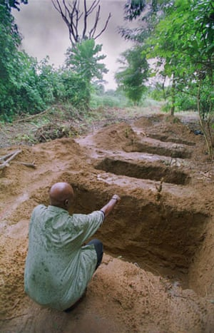 Shell in the Niger Delta: Graves at a cemetery in Nigeria where Ken Saro Wiwa may be buried