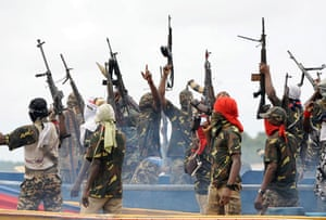 Shell in the Niger Delta: Fighters with the Movement for Emancipation of the Niger Delta celebrate.