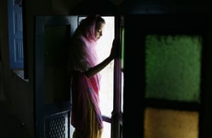 20 May 2009: Hasanabdal, Pakistan: A girl looks out of a room at a Sikh temple