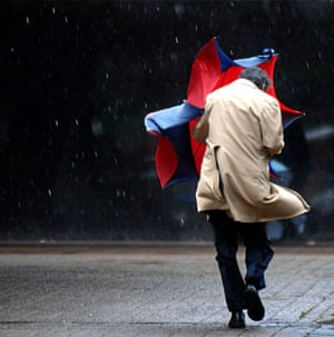 20 May 2009: Jacksonville, UK: A man and his umbrella battle the wind and rain