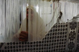 20 May 2009: Babar, Algeria: A woman weaves carpet at her house