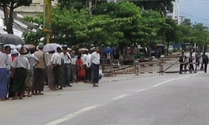 Supporters of Aung San Suu Kyi near the prison where her trial is being held
