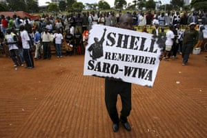 Shell in the Niger Delta: A participant holds a placard saying Shell, Remember Saro-Wiwa