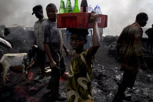 Shell in the Niger Delta: A young girl sells drinks in the abbatoir of Port Harcourt, Nigeria