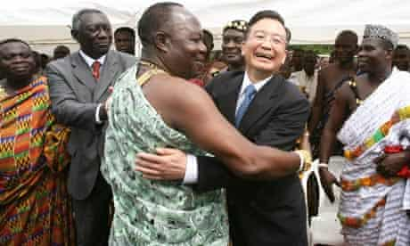 Chinese Premier Wen Jiabao embraces a local chief during a visit to Accra, Ghana, in 2006.
