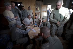 Sean Smith in Afghanistan: American Army troops from Apache company play cards at FOB Tarwah