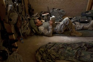 Sean Smith in Afghanistan: An American Army soldier reads in the sleeping quarters at FOB Tarwah.
