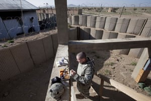 Sean Smith in Afghanistan: A soldier eats breakfast while on guard duty at FOB Waza Kwah.