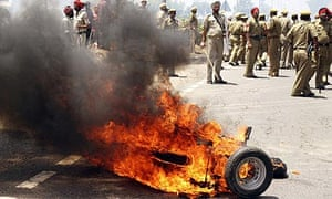 Police in Jalandhar. Riots flared after a Sikh leader was killed in Austria.
