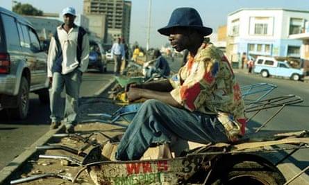 Wheelbarrow pusher in Zambia