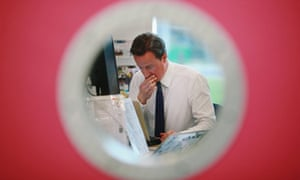David Cameron works at a computer in the Digilab of The Open University