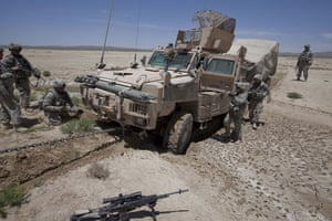 Sean Smith Afghanistan: American Army troops free an MRAP vehicle after it became stuck