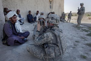 Sean Smith Afghanistan: American Army troops photograph and fingerprint villagers