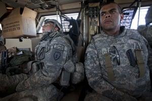 Sean Smith Afghanistan: A soldier sleeps in an MRAP vehicle near Shahin Kalay