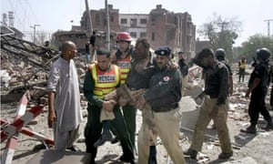 Rescue workers and police help the injured in Lahore