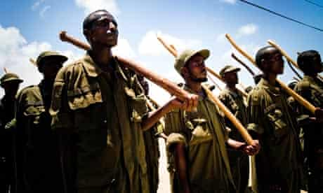 Islamic Courts fighters train on the grounds of the Presidential Palace in Mogadishu, Somalia