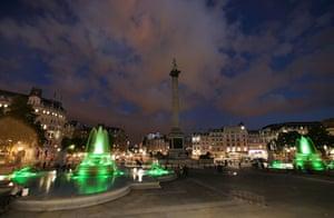 Trafalgar Square fountain: The fountains glow green