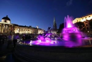 Trafalgar Square fountain: Bright purple lights