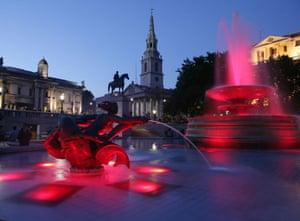 Trafalgar Square fountain: The lights glow bright red