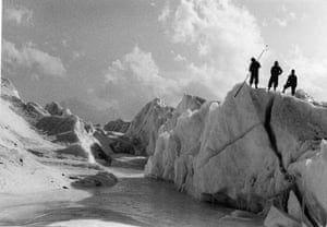 Changing Landscapes: Khumbu, Nepal, 1956: A research team stand on a serac to inspect the ice