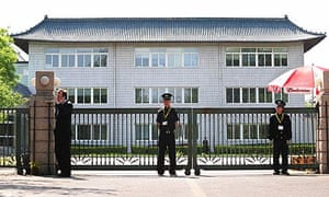 Security guards in front of a sealed-off hotel where Mexican nationals are held under quarantine
