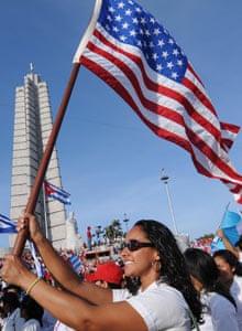 Student waving US flag, Havana, Cuba
