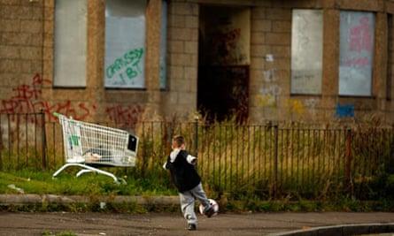 Child plays in Govan, Glasgow