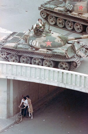 Tiananmen Square: A Chinese couple on a bicycle take cover in an underpass in Beijing