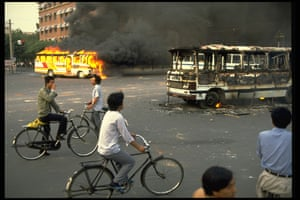 Tiananmen Square: Buses burn in the street by Tiananmen Square