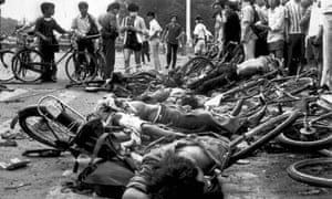 Bodies of dead civilians lie among mangled bicycles near Beijing's Tiananmen Square, 4 June 1989