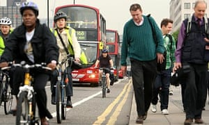 Commuters cross Waterloo bridge in central London during the tube strike