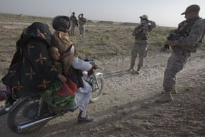 Sean Smith in Afghanistan: American soldiers from Charlie Company stop a passing bike