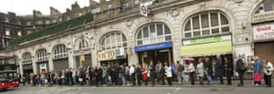 Tube strike: Victoria train station: Commuters queue for buses outside