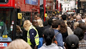 Tube strike: Victoria station: Commuters try to board a bus
