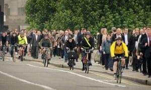 Tube strike: Waterloo Bridge: Commuters walk and cycle across the bridge