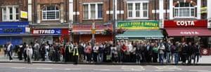 Tube strike: Shepherds Bush: Commuters queue for buses