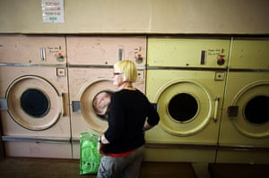 Burnley vote BNP: woman tends to her washing in a launderette in the Padiham area of Burnley