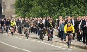 London commuters cycling across Waterloo bridge