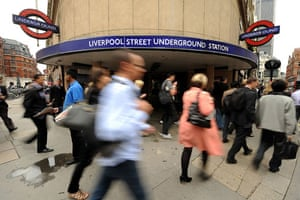 Tube strike: Commuters walk past a closed underground station
