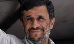 Iran's President Mahmoud Ahmadinejad, greets his supporters after voting in the elections in Tehran