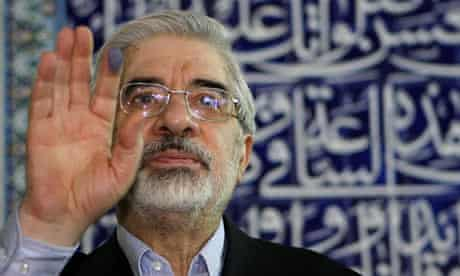Former Iranian prime minister and presidential candidate, Mir Hossein Mousavi waves after voting