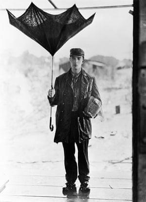 Hooray for hollywood: Buster Keaton Holding Broken Umbrella in <Steamboat Bill, Jr.>