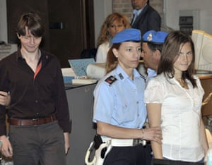 Meredith Kercher trial: Amanda Knox and Raffaele Sollecito are escorted by police officers