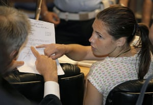 Meredith Kercher trial: Amanda Knox speaks with her lawyer prior to a session of the trial
