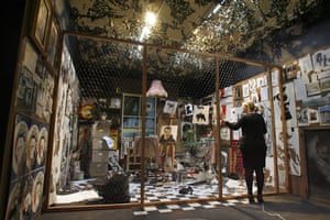 Banksy exhibition Bristol: A woman looks at a montage of works by Banksy at the Bristol City Museum