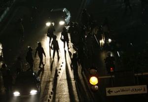 Riots in Tehran: Iranian policemen patrol the streets in Tehran