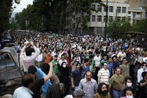Riots in Tehran: Supporters of Mir Hossein Mousavi march through Valiasr Street in Tehran
