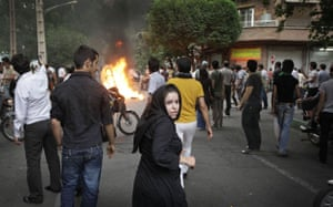 Riots in Tehran: An Iranian girl amongst protesters on the streets of Tehran