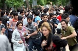 Riots in Tehran: Demonstrators flee from riot police in Tehran