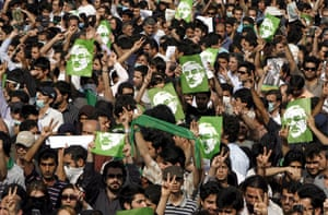 Tehran protest: Protestors wave pictures of Mousavi